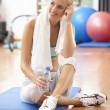 Woman Resting After Exercises In Gym — Stock Photo