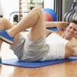 Man Doing Stretching Exercises In Gym — Stock Photo