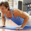 Man Doing Press Ups In Gym — Stock Photo