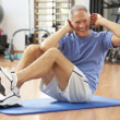 Senior Man Doing Sit Ups In Gym — Stock Photo