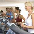 Senior Woman On Running Machine In Gym — Stock Photo