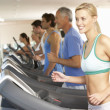 Woman On Running Machine In Gym — Stock Photo #4842986