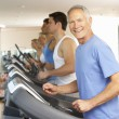 Senior Man On Running Machine In Gym — Stock Photo