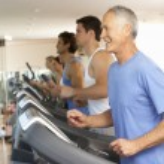 Senior Man On Running Machine In Gym — Stock Photo