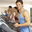 Man On Running Machine In Gym — Stock Photo #4842992