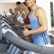 Man On Running Machine In Gym - Stock Photo