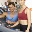 Woman Working With Personal Trainer On Running Machine In Gym — Stock Photo #4842996