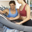 Woman Working With Personal Trainer On Running Machine In Gym — Stock Photo #4842997