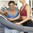 Woman Working With Personal Trainer On Running Machine In Gym — Stock Photo #4842998