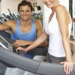 Senior Woman Working With Personal Trainer On Running Machine In — Stock Photo #4842999