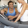 Senior Woman Working With Personal Trainer On Running Machine In — Stock Photo #4843001