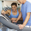 Man Working With Personal Trainer On Running Machine In Gym — Stock Photo #4843003