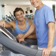 Man Working With Personal Trainer On Running Machine In Gym — Stock Photo #4843005