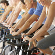 Stock Photo: Senior Woman Cycling In Spinning Class In Gym