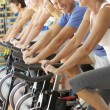 Stock Photo: Senior Man Cycling In Spinning Class In Gym