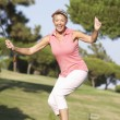 Senior Female Golfer On Golf Course Lining Up Putt On Green — Stock Photo