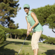 Female Golfer On Golf Course Putting On Green — Stock Photo #4843092