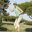 Female Golfer On Golf Course Putting On Green - Lizenzfreies Foto