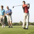 Group Of Male Golfers Teeing Off On Golf Course — Stock Photo #4843124