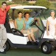 Group Of Friends Riding In Golf Buggy On Golf Course — Stock Photo #4843137
