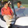 Two Male Golfers Riding In Golf Buggy On Golf Course — Stock Photo #4843142