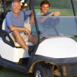 Two Male Golfers Riding In Golf Buggy On Golf Course — Stock Photo #4843143