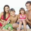Portrait Of Family On Summer Beach Holiday - Foto Stock