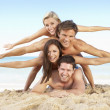 Group Of Friends Enjoying Beach Holiday - Stock Photo