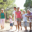 A family, with parents, children and grandparents, walk through — Stock Photo