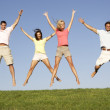 Young couples jumping in air — Stock Photo