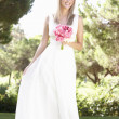 Bride Wearing Dress Holding Bouqet At Wedding - Stock Photo