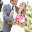 Portrait Of Bridal Couple Outdoors - Stock Photo