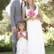 Bride And Groom With Bridesmaid At Wedding — Stockfoto