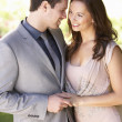 Smartly Dressed Young couple in park - Stock Photo