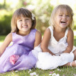 Two young girls posing in park - Foto Stock