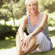 Middle age woman posing in park — Stock Photo