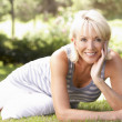 Middle age woman posing in park — Photo