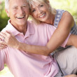 Senior couple relaxing together in park — Stockfoto #4843556