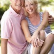 Senior couple relaxing together in park — Stockfoto #4843559