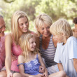 A family, with parents, children and grandparents, relaxing in a — Stock Photo