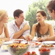 Two young couples eating outdoors — Stock Photo #4843687