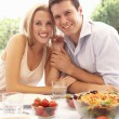 Young couple eating outdoors — Stock Photo #4843694