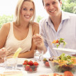 Stock Photo: Young couple eating outdoors
