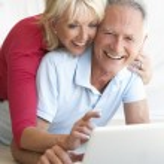 Senior couple on her laptop computer — Stock Photo