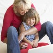Middle age woman with young girl using laptop computer — Photo
