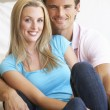 Stock Photo: Young couple posing indoors