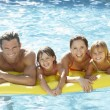 Young family, parents with children, in pool — Stok Fotoğraf #4843915