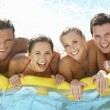 Group of Young friends having fun in pool — Stock Photo #4843920