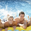 Young family having fun together in pool — Stock Photo