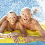 Senior couple having fun in pool — Stock Photo